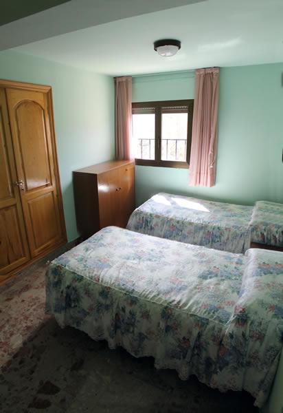Habitación con camas individuales en Guadalaviar